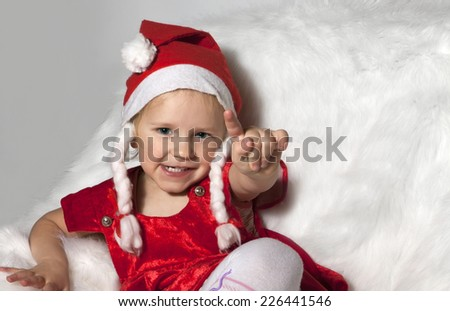 little child with christmas hat