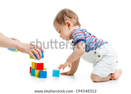 little child with construction set over white background - stock photo