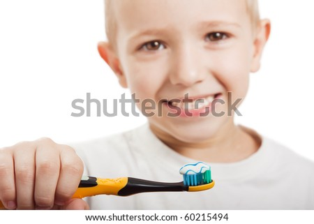 Little child with dental toothbrush brushing teeth - stock photo
