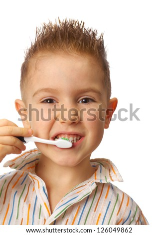 Little child with dental toothbrush brushing teeth.isolated on a white background. - stock photo