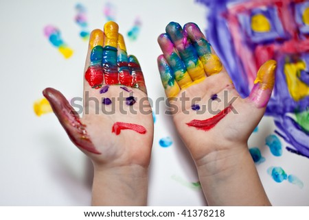 Little Children Hands doing Fingerpainting with various colors