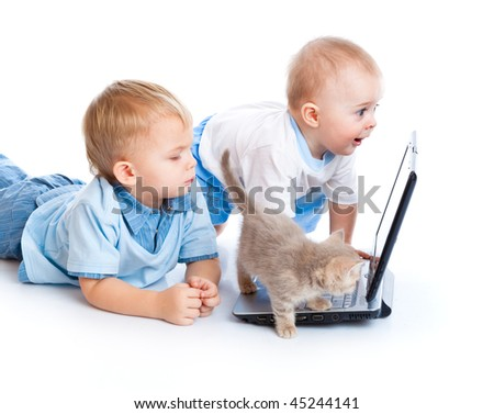 Little children, kitten, and laptop. Isolated on white background - stock photo