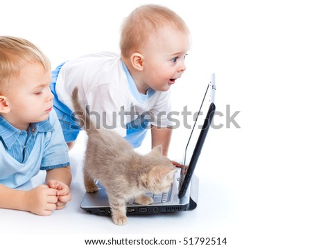Little children, kitten, and laptop. Isolated on white background
