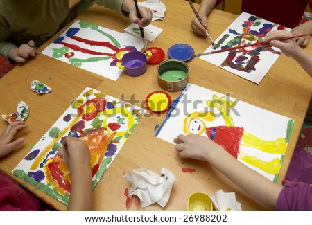 little children painting during art class - stock photo