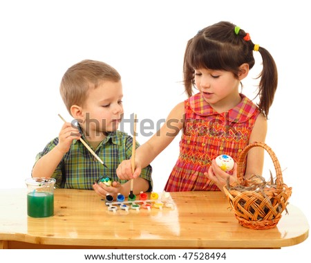 Little children painting the easter eggs