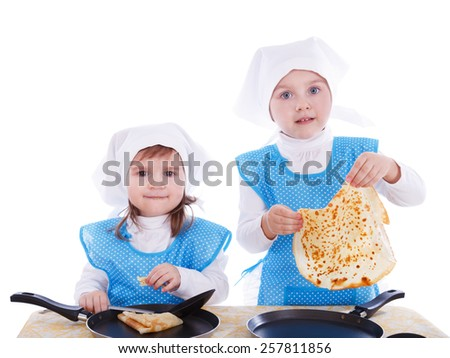 Little children with pancakes. Two cute girls playing as chefs. Surprise for Mother Day. Isolated on a white background. - stock photo