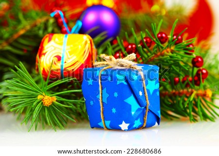 Little christmas gift boxes with branch of fir and decorations, selective focus - stock photo