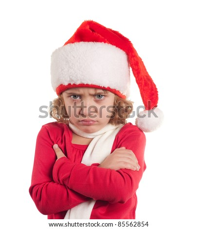 Little christmas girl wearing Santa hat. Isolated on white background.