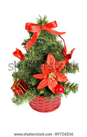 Little christmas tree with decorations isolated on white background
