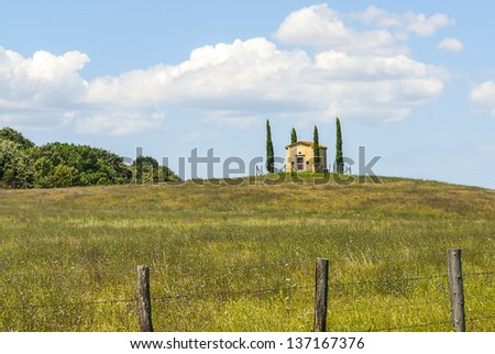 Little church with cypresses in the countryside near Volterra (Pisa, Tuscany, Italy)