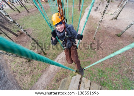 Little climber finished passage ropes course - stock photo
