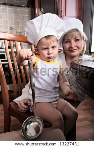 Little cook and his mather: fruits and baby food - stock photo