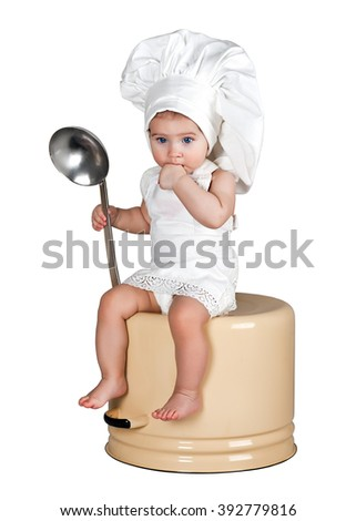Little cook sitting on the pot - stock photo