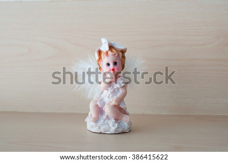 Little Cupid with on background - stock photo