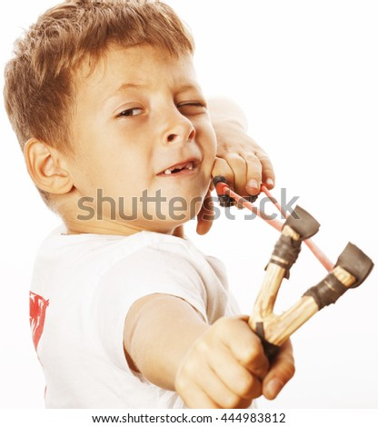 little cute angry real boy with slingshot isolated - stock photo