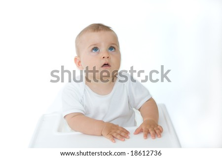 little, cute baby boy looking up, on white