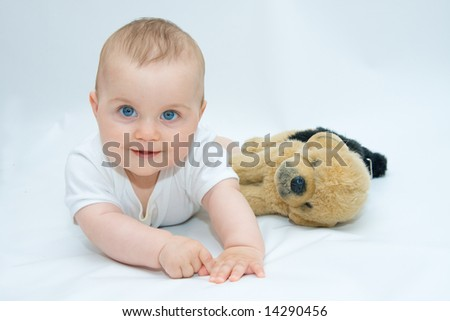little, cute baby boy lying on white background - stock photo