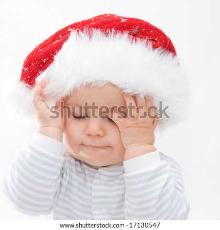 little, cute baby boy wearing Christmas hat, on white - stock photo