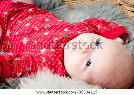 Little cute baby in red