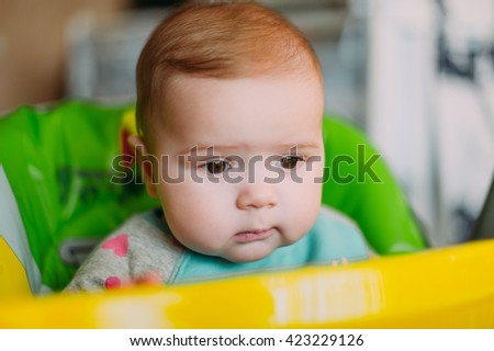 little cute baby toddler on carpet close up smiling adorable happy emotional playing at home sitting on his table - stock photo