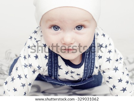 little cute baby toddler on carpet isolated close up smiling - stock photo