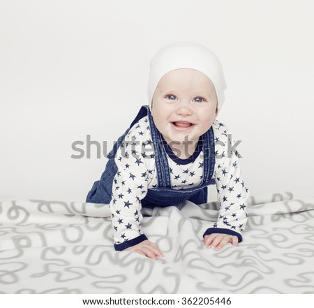 little cute baby toddler on carpet isolated close up smiling, adorable kid - stock photo