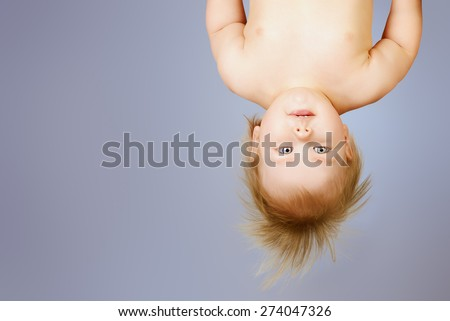 Little cute baby upside down. Childhood. Healthcare. - stock photo