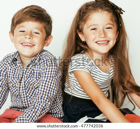 little cute boy and girl hugging playing on white background, happy family smiling twins