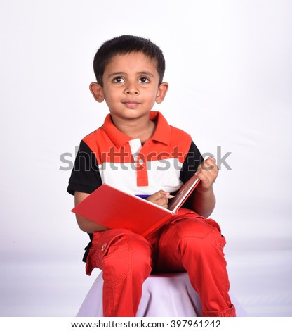 Little cute boy drawing with colorful pencil. - stock photo