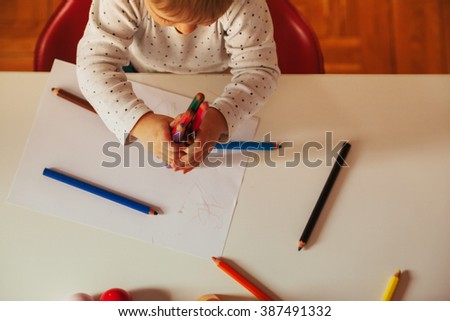 Little Cute Boy Drawing With Colorful Pencils - stock photo
