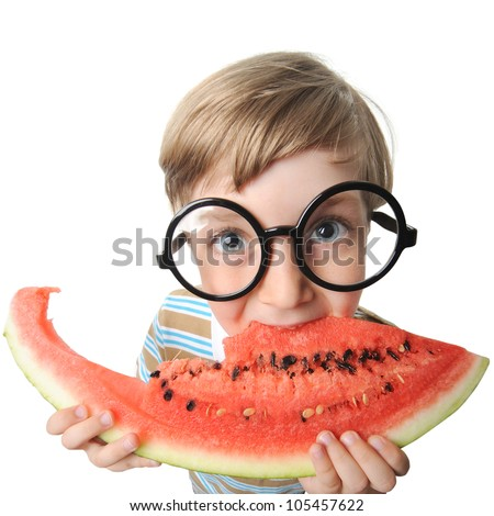 little cute boy eating a watermelon - stock photo