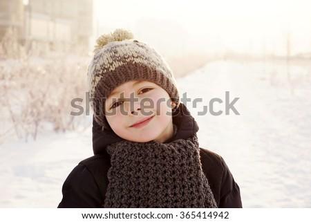 little cute boy having fun outside, winter time - stock photo