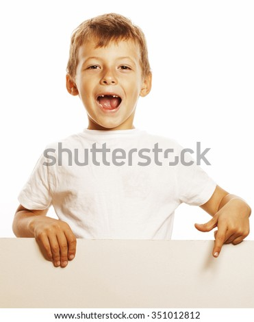 little cute boy holding empty shit to copyspace card isolated close up gesturing smiling - stock photo