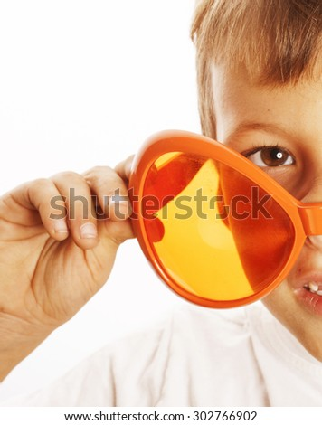 little cute boy in orange sunglasses pointing isolated close up like alien - stock photo