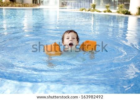 little cute boy in swimming pool - stock photo