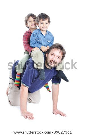 Little cute boy on his father's back playing