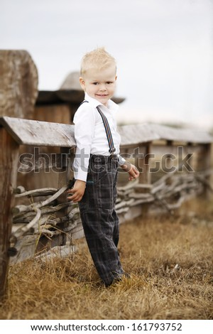 little cute boy portirat on location - stock photo