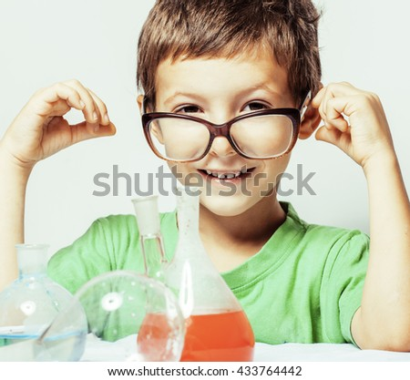 little cute boy with medicine glass isolated wearing glasses smi - stock photo