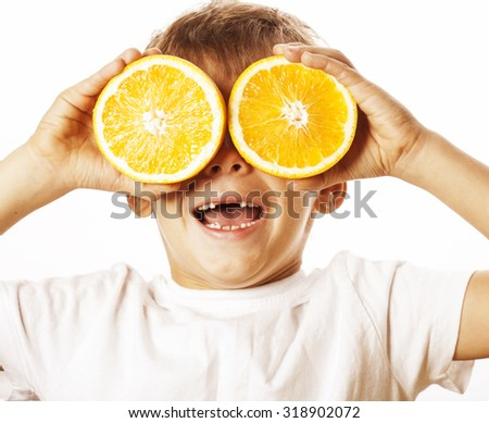 little cute boy with orange fruit double isolated on white smiling without front teeth adorable - stock photo