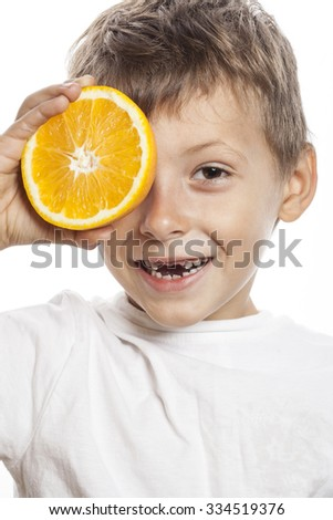 little cute boy with orange fruit double isolated on white smiling without front teeth adorable fresh - stock photo