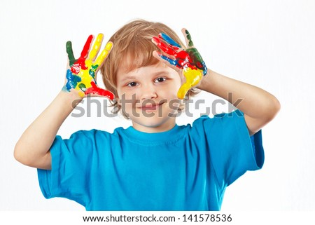 Little cute boy with painted hands on a white background
