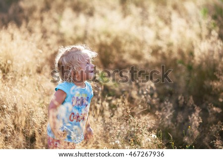 Little cute cheerful girl walking, outdoor