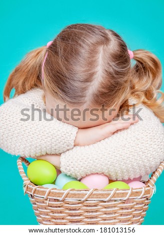little cute female protecting easter eggs - stock photo
