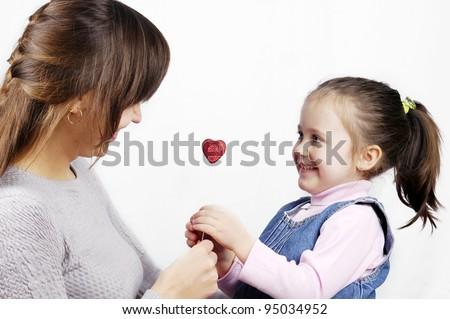little cute girl gives mom heart - stock photo