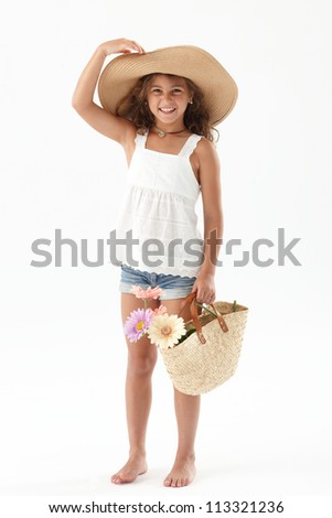 Little cute girl holding a basket with flowers
