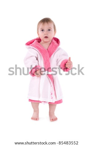 little cute girl in a bathrobe isolated on a white background - stock photo