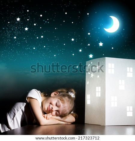 Little cute girl in darkness dreaming about home and family - stock photo
