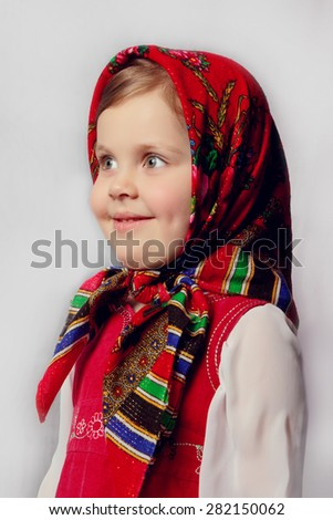 Little cute girl in Russian folk clothes. traditions - stock photo