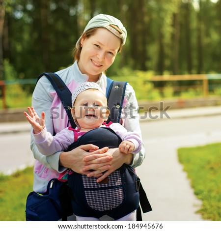 little cute girl in sling. - stock photo