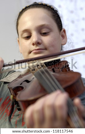 Little cute girl learn viola lesson - stock photo